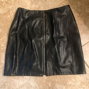 Dresses & Skirts - Black leather skirt. Zips front.